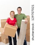 Happy couple moving into a new home together - stock photo