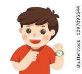 happy boy showing wrist watch.... | Shutterstock .eps vector #1297095544