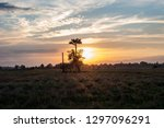 meadow and sky and golden...   Shutterstock . vector #1297096291