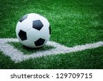soccer ball on soccer field | Shutterstock . vector #129709715