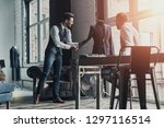 sharing ideas. two young...   Shutterstock . vector #1297116514