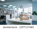 stack of books and glasses on... | Shutterstock . vector #1297117681