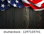 American Flag On Dark Wooden...