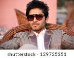 portrait of a hansome bi racial ... | Shutterstock . vector #129725351