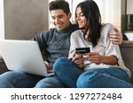 happy young couple sitting on a ... | Shutterstock . vector #1297272484