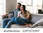 happy young couple sitting on a ... | Shutterstock . vector #1297272547