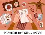 woman s hands holding pen and... | Shutterstock .eps vector #1297349794