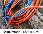 laying a fiber optic cable for... | Shutterstock . vector #1297464691