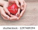 close up red heart in hands ... | Shutterstock . vector #1297489294