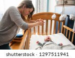 tired mother with upset baby... | Shutterstock . vector #1297511941