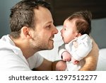 father and newborn baby closeup ... | Shutterstock . vector #1297512277
