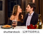 beautiful couple in a... | Shutterstock . vector #1297535911