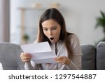 amazed happy teen girl holding...   Shutterstock . vector #1297544887