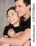 affectionate couple hugging... | Shutterstock . vector #1297570864