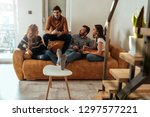 friends chilling at home and... | Shutterstock . vector #1297577221