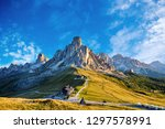 giau pass at daylight. road to... | Shutterstock . vector #1297578991