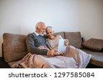 senior couple using digital... | Shutterstock . vector #1297585084