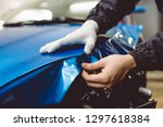car wrapping specialist putting ... | Shutterstock . vector #1297618384