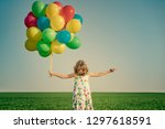 happy child playing with bright ... | Shutterstock . vector #1297618591
