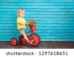 funny child riding bike. happy... | Shutterstock . vector #1297618651
