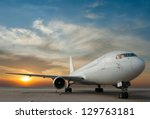 commercial airplane with sunset | Shutterstock . vector #129763181
