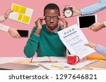 concentrated black man keeps... | Shutterstock . vector #1297646821