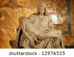 Small photo of Michelangelo's Pieta in St. Peter's Basilica in Rome. c 1498-99