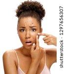 scowling girl in shock of her...   Shutterstock . vector #1297656307