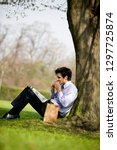 businessman in city park having ... | Shutterstock . vector #1297725874