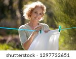 a mature woman pegging out... | Shutterstock . vector #1297732651