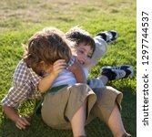 two young boys having fun... | Shutterstock . vector #1297744537