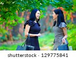 beautiful happy women talking in colorful park - stock photo