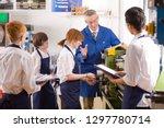 teacher demonstrating lathe to... | Shutterstock . vector #1297780714