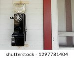 antique payphone. old obsolete... | Shutterstock . vector #1297781404