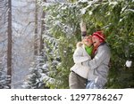 laughing couple on winter... | Shutterstock . vector #1297786267