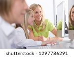 female teacher helping students ... | Shutterstock . vector #1297786291