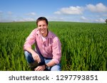 portrait of smiling farmer... | Shutterstock . vector #1297793851