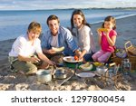 family having barbecue picnic... | Shutterstock . vector #1297800454