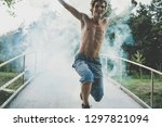 the guy is holding a smoke... | Shutterstock . vector #1297821094
