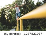 the guy is holding a smoke... | Shutterstock . vector #1297821097