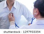 the doctor is diagnosing the... | Shutterstock . vector #1297933354