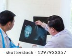 the doctor is diagnosing the... | Shutterstock . vector #1297933357