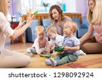 young moms and their kids... | Shutterstock . vector #1298092924