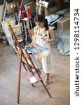 woman artist painting picture...   Shutterstock . vector #1298114734