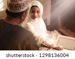 Religious Asian Muslim Man...
