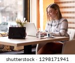 portrait of young woman using... | Shutterstock . vector #1298171941