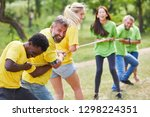 two teams tug of war with rope... | Shutterstock . vector #1298224351