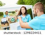 young volunteer volunteers are... | Shutterstock . vector #1298224411