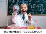funny happy boy dressed as... | Shutterstock . vector #1298229007