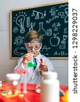 boy dressed as chemist playing... | Shutterstock . vector #1298229037